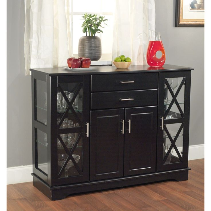 Create more space in your dining room or living room with this elegant Aria Buffet in black finish that will match with any decor. This buffet offers both glass and solid doors a classic style. The X style door features two adjustable tempered glass