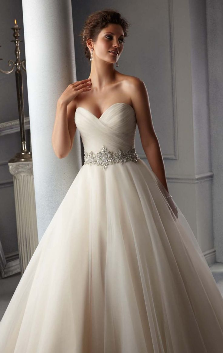 Fashion your fantasy wedding in Blu by Mori Lee 5276. This wedding gown complements a strapless sweetheart neckline with mid back design. A fitted ruched bodice with beaded waistband that will shine all day long. The A line ball gown skirt with train will surprise everyone as you walk with elegance.