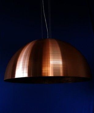 A large modern dome pendant in Copper. (also available in brushed aluminum and a range of colours.) This pendant will suit both domestic and commercial applications.  The Orbit 750 comes standard with an E27 lamp holder, 100mm diameter x 25mm canopy and 1m of flex on 3 stainless steel suspension wires, but can also be fitted with a rod if prefered. This pendant can be fitted with energy saving globes.