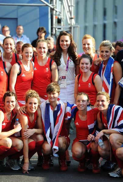 Catherine, Duchess of Cambridge celebrates with Team Great Britain after their Women's Hockey bronze medal match against New Zealand.