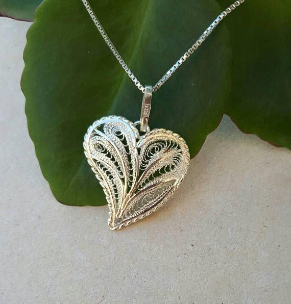 Check out this item in my Etsy shop https://www.etsy.com/uk/listing/253452271/handmade-sterling-silver-filigree-heart