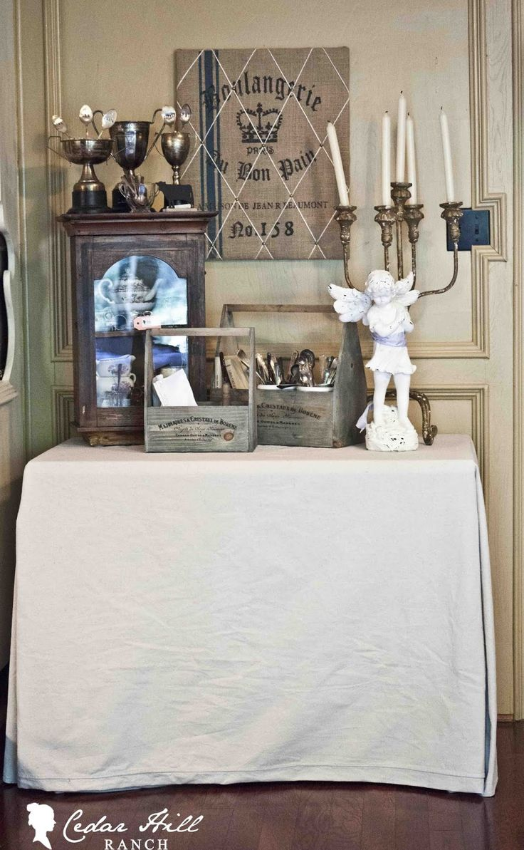 Cover your table with this easy no sew drop cloth table cover
