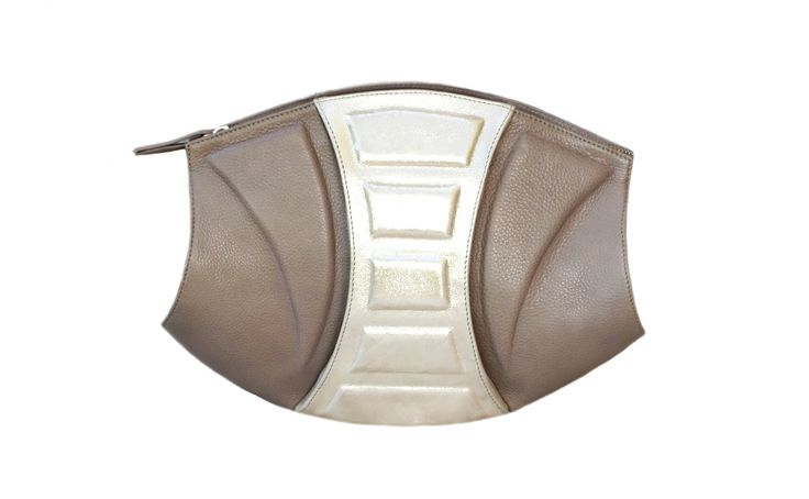 Aphrodite Mini Bag belongs to the family of luxurious geometrical handbags that will leave true accessory lovers breathless with their design and high quality. This multidimensional and rather unusual handbag can turn into a chic evening clutch with its strap off, while the cleverly designed interior allows for combinations with a long shoulder strap, making it suitable for everyday use.                  TAGS: luxury, clutch, hobo, designer, leather, handmade, bag, design, tote, unique…