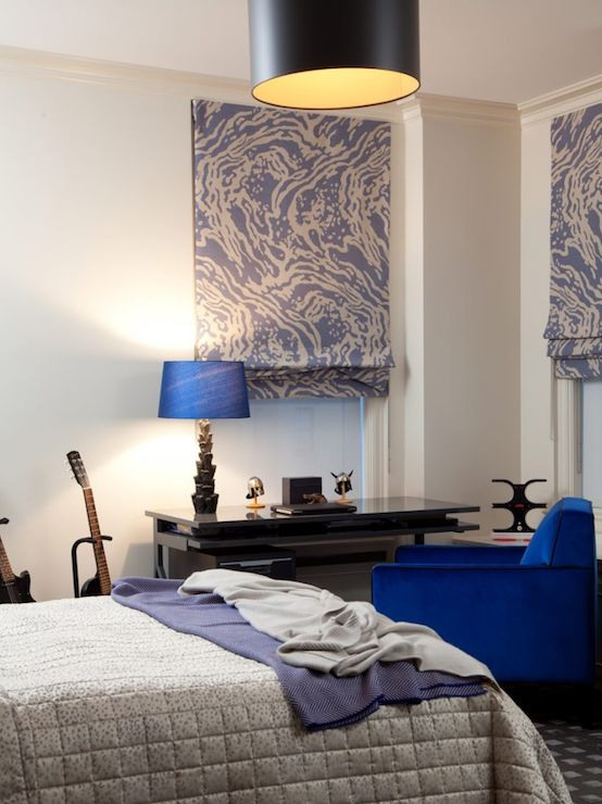 Boy 39 s bedroom with cobalt blue chair paired with glossy for Chair for boys room