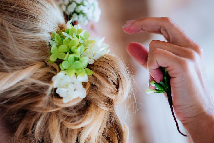 A detail of the hair up do. These little green and white flowers are perfect.