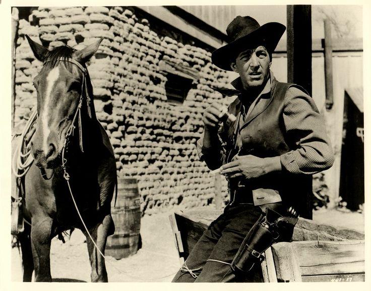 "RIO BRAVO (1959) - Dean Martin struggles as John Wayne's alcoholic deputy, ""Dude"" - Directed by Howard Hawks - Warner Bros. - Publicity Still."