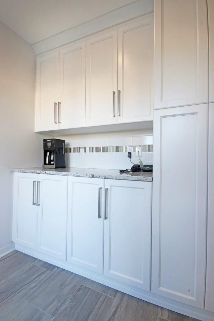 Crisp white cabinetry in this beverage centre