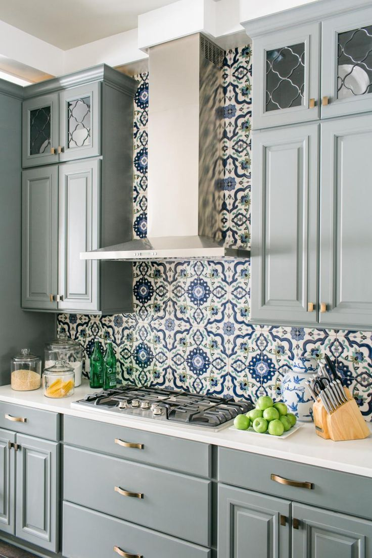 blue and grey kitchen backsplash in moroccan patterns combined with grey cabinets with white counter tops