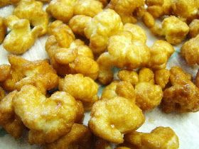 Caramel Puff Corn 1 cup brown sugar 1 stick butter 1/4 cup corn syrup 1/2 tsp baking soda 1 bag Puffed Popcorn (plain or buttered) 1 paper bag Put Puff corn in paper bag. Boil the brown sugar, butter, corn syrup for two minutes on the stove top. Remove from heat and stir in the baking soda. Pour into the grocery sack, over the puffed popcorn. Shake well. Fold down top of bag and microwave for 1 minute. Remove and shake well. Repeat 2 more times. Spread onto waxed paper to cool and dry.