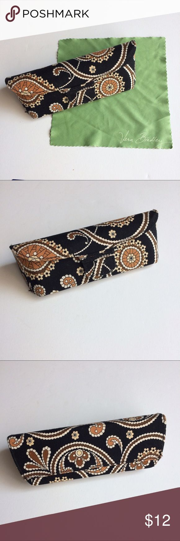 """Vera Bradley Caffe Latte eyeglass case For sale is an eyeglass case by Vera Bradley.  Pattern is Caffe Latte in gorgeous shades of black brown tan and creme.  Case is covered in cotton fabric.  Structured shell with a magnetic closure.  Always kept my glasses safe while in my purse with other items.  Comes with a handy cleaning cloth too!  Measurements are 6.5"""" L x 1 3/4"""" W x 2.5"""" H.  Comes from smoke free and pet free home.  Thanks for looking! Vera Bradley Accessories Glasses"""