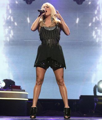 There's no question country cutie Carrie Underwood has some amazing pipes, but she may just have some of the best limbs in the biz too. And if you haven't seen her new album cover yet, be prepared to