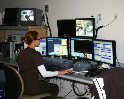 Radiation technician monitoring the treatment