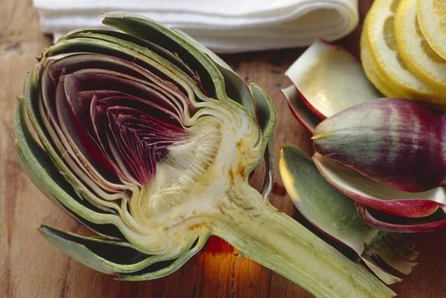 Natural treatments to lower high cholesterol, including supplements such as artichoke, niacin, plant stanols/sterols, and more.