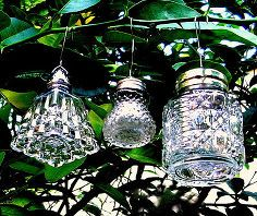 crystal ornaments made from vintage salt shakers, christmas decorations, repurposing upcycling, seasonal holiday decor, The small ones are light enough to hang on most trees Aren t they glitzy And the variety of shakers is endless To hang thread the bottom curve of a wire ornament hanger through two of the holes in the lid