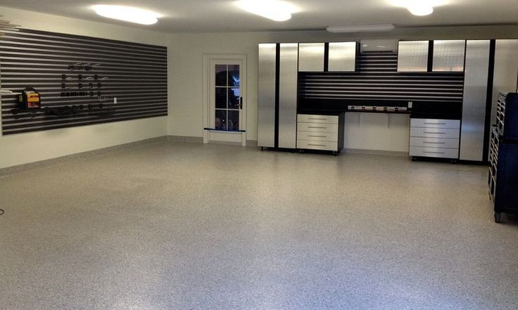 Epoxy coated garage floor coating with a polyaspartic top coat by The Garage Enhancement Company