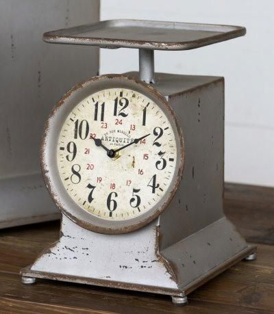 This cute Little Grocery Scale Clock is a smaller version of our super popular Grocery Scale Clock! It adds a lovely Farmhouse feel to any kitchen!  7.25 x 7.7