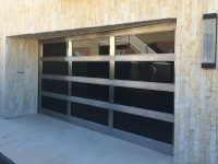 Winchester style custom garage door with triple sided feature door can allow you to work with thick aluminum frames or small composite panels in any texture - Automatic Remote Access
