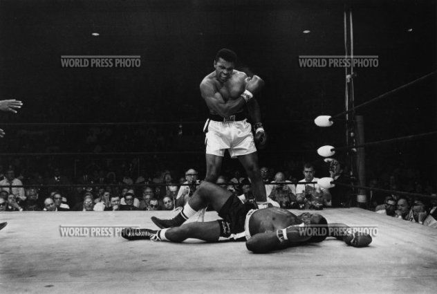 "1965, John Rooney, 1st prize, Sports  ""Muhammad Ali, boxing heavyweight world champion, finishes off his challenger e-Champion Sonny Liston in 60 seconds."""