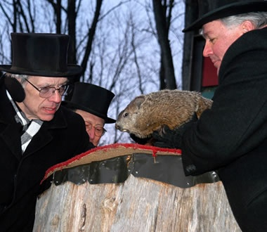 www.groundhog.org Go to Teacher's tab. Scroll down for fun songs sung to the tune of Christmas carols