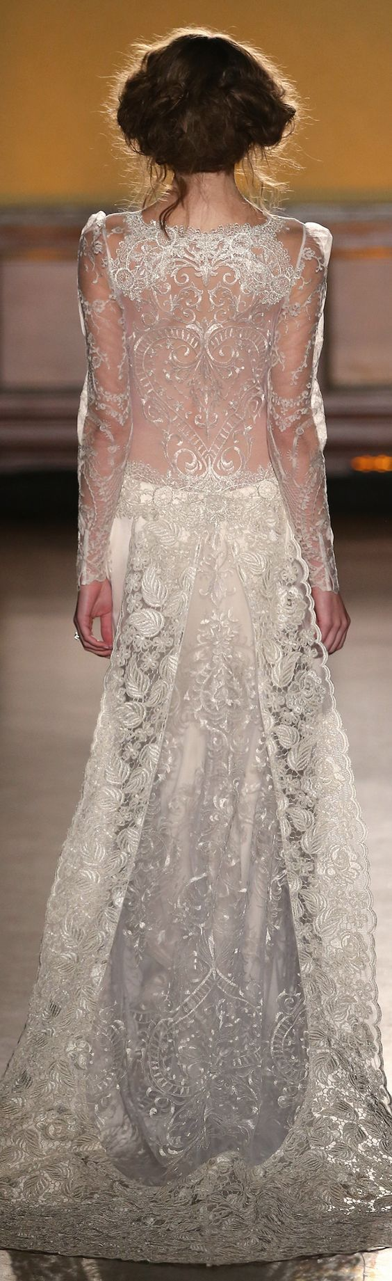 Delicate French embroidery gives such a beautiful illusion effect on the scalloped neckline, and barely there long sleeves of Sinclair by Claire Pettibone. The stunning sheer back is made of pale silver metallic thread in a graceful heart pattern, and the same motif trails along the skirt. The removable train features luxe scalloped lace for a stunning back view.   https://couture.clairepettibone.com/collections/the-gilded-age/products/sinclair