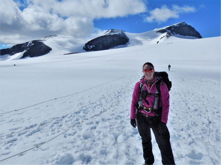 Me in front of Norwegians highest mountain, Mount Galdhøpiggen (2469), in July.