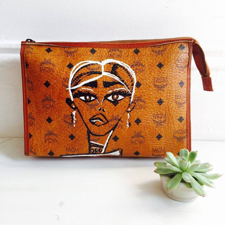 A personal favorite from my Etsy shop https://www.etsy.com/listing/258568465/painted-vintage-mcm-clutch-handpainted