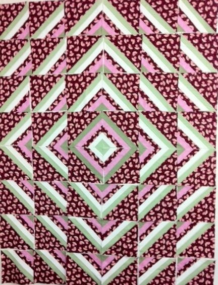 A Roman Stripe quilt top laid out on the design wall ... www.hughsbooks.ca