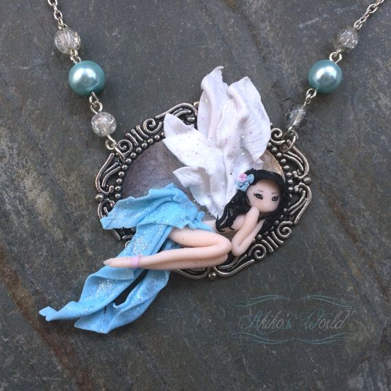 Tiny blue fairy made out of #fimo / # polymerclay, avaible on # Etsy