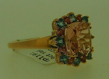 A stunning 9 Carat Gold Morganite, Pink tourmaline and Blue Serendibite gemstone Ring A large square Morganite stone is surrounded by eight Pink tourmaline and