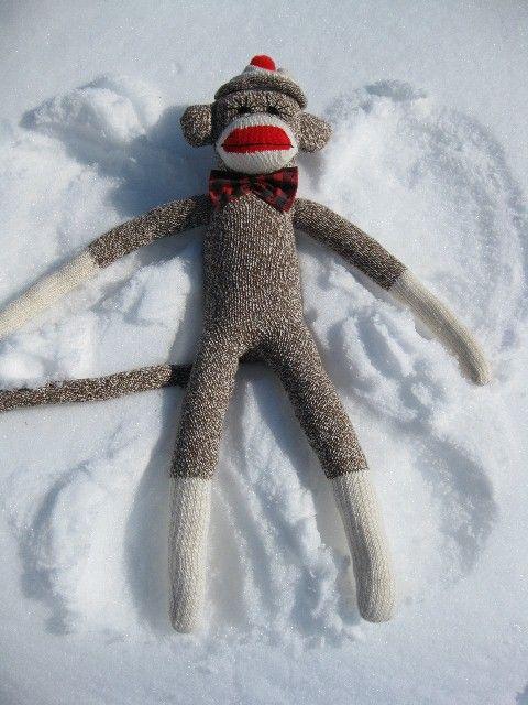 Sock monkey snow angel