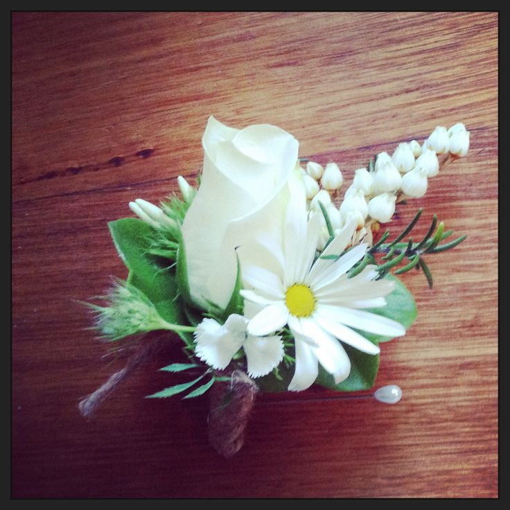 Garden style boutonnière with chamomile, pieris, sweet William, geranium, rosemary and Bianca rose bound in twine.