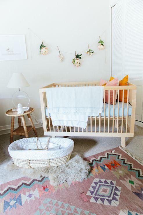 Adorable Nursery Features A Modern Wood Crib And Woven Moses Basket Atop Sheepskin Layered Babies Nurserynursery Rugswood