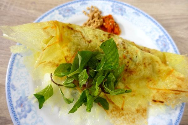 Vegetarian in Vientiane, Laos? Banh xeo topped with fresh mint leaves - the Veggie Buffet has a great spread of genuine Lao vegetarian dishes - cooked fresh every day   Eat Drink Laos http://eatdrinklaos.com/blog/vientiane-veggie-buffet