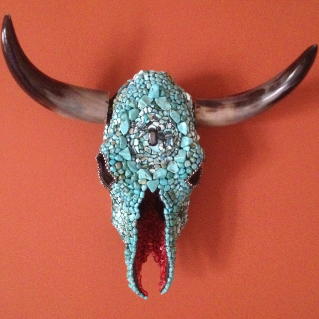 Inspiration. Decorated cow skull  Wondering if it could be done with aqua aquarium rock and clear coated.