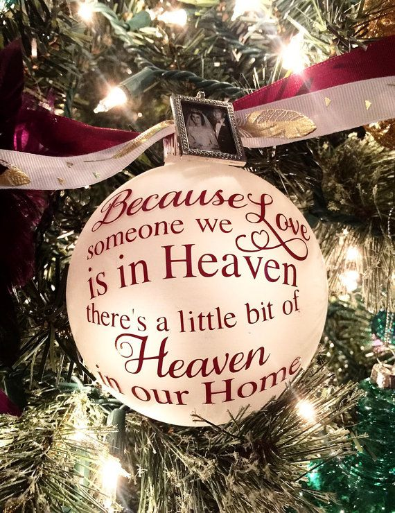 In Loving Memory Ornament - Because Someone We Love is in Heaven Theres a Little Bit of Heaven in Our Home Christmas Ornaments. This is a frosted 4 glass ornament with a burgundy quote and ribbon. **We are now out of the feather ribbon, so it will just be the burgundy ribbon on the top.**  The frame on the ornament is an upgrade that you will find in the drop box. *If you choose to have the frame added you will be able to add a picture when the ornament arrives. The picture can be changed…