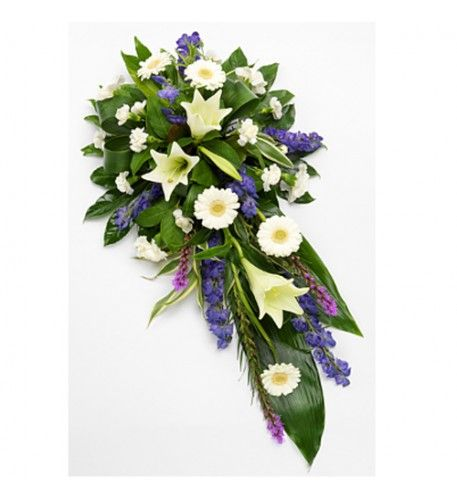 A gorgeous white and purple single ended spray. White Longiflorum Lilies, Germini and Carnations are interspersed with purple Aconitum and Liatris. Luscious green foliage completes the design beautifully.