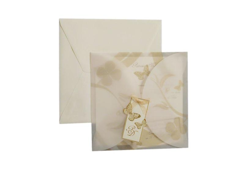 Partecipazioni in carta pergamena con fiorellini disegnati..