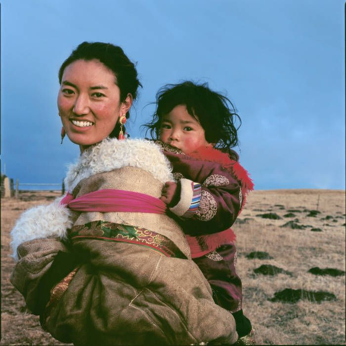 I watched a Tibetan mother, who took her son to the Sunning Buddha Festival, in Longwu Temple, Huangnan Prefecture, Qinghai Province, during the Spring Festival in 2008. When I offered to take a photo of them, the mother readily agreed. The boy leaned against his mother, and then looked at me with curiosity. When I raised the camera and pressed the shutter button, the mother smiled