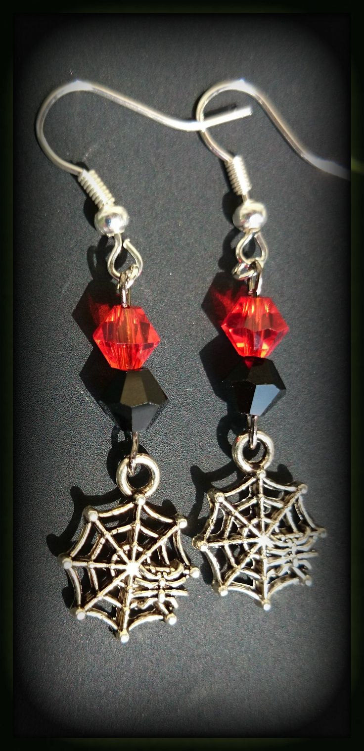 Spider webs dangle from your ears in this perfect for Halloween or Gothic attire ensemble. Available at www.etsy.com/shop/zordiascreations
