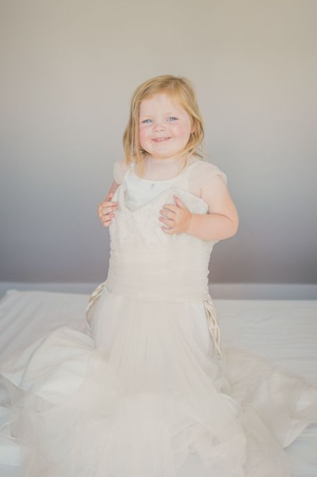 The brides daughter in mums wedding dress.