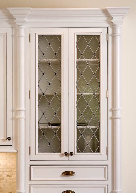 Love these cabinets- seeded glass with diamond pattern in antique white!