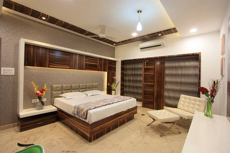 View of son 39 s bedroom in first floor which has access to a for Grand bedroom designs