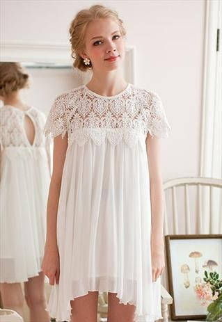White eyelet lace pleated babydoll dress. Would be a beautiful rehersal dinner dress