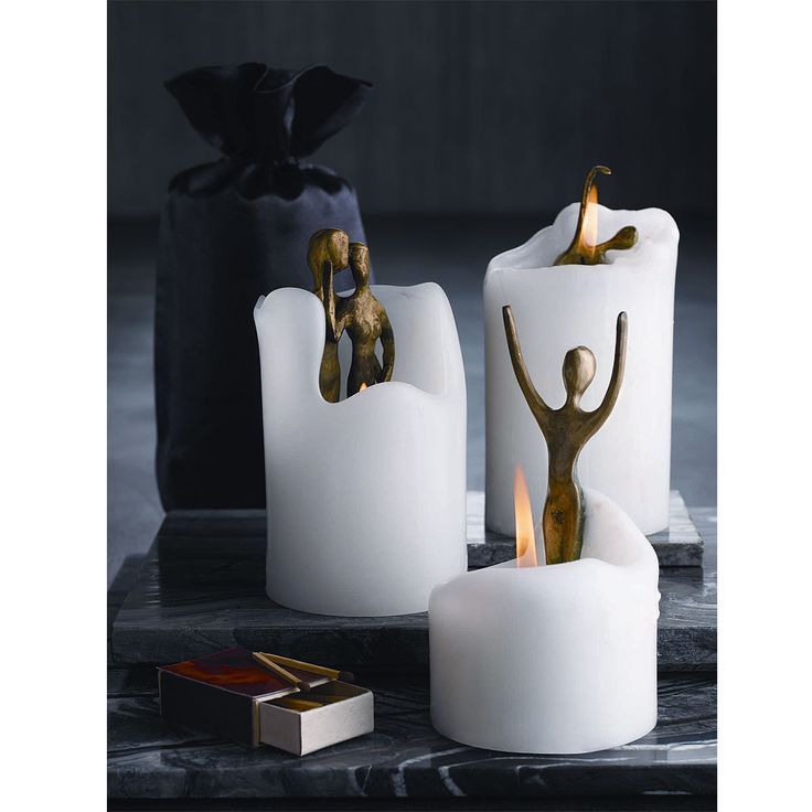 """Dance"" and ""Embrace"" Spirit Candles melt to reveal bronze sculptures."