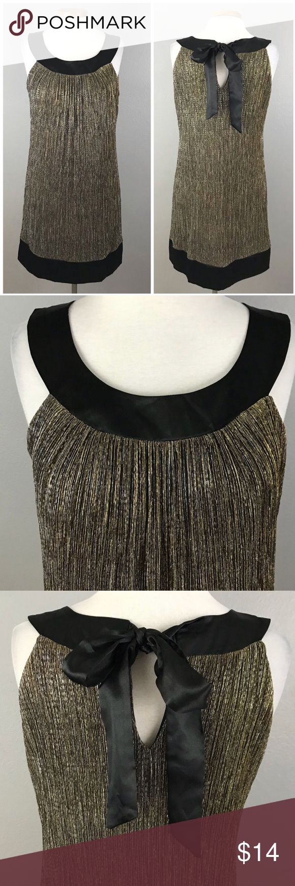 """Enfocus Micro Pleated Gold Silver Party Dress Enfocus Micro Pleated Gold Silver Party Dress. Size 12. Dress has stretch and is lined. Thank you for looking at my listing. Please feel free to comment with any questions (no trades/modeling).  •Bust: 42"""" •Length: 36"""" •Condition:  VGUC, no flaws.   25% off all Bundles or 3+ items! Reasonable offers welcome.   BIN: JC En Focus Studio Dresses Mini"""