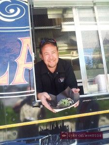 BlackJack Gastrovan Nominated | AwesTruck 2013 Food Truck Festival  In this photo, owner John Neill serves up some amazing Drunken Wings in the parking lot of Jack's Gastropub in Kingsville. While the hit show You Gotta Eat Here! filmed an episode inside the restaurant. The episode should air this 2013/2014 season.