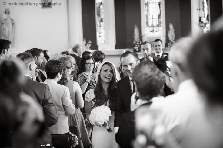 A Bride & groom walking down a crowded aisle wedding photography donegal