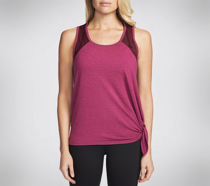 The SKECHERS Apparel Castle Peak Side Tie Tank Top. Poly and Rayon fabric in a relaxed easy fit side tie tank top design with Active Stretch fabric for maximum comfort.