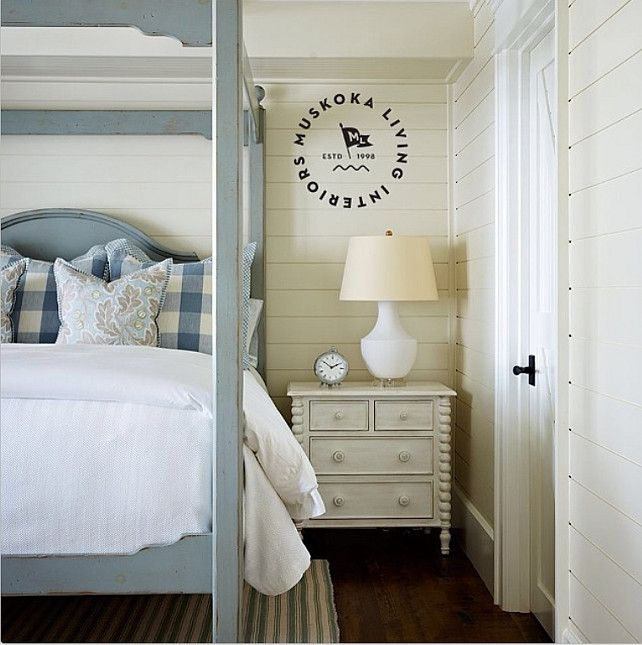 Cottage Bedroom with plank walls
