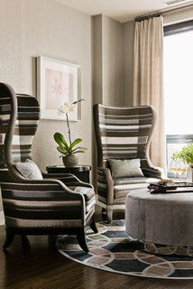 High-back chairs are perfect for corners. Most people like the look of high-back chairs but consider their height a visual challenge. Place two high-back chairs in a corner facing out. Add a small table in between and a rug. This creates a perfectly cozy sitting area.